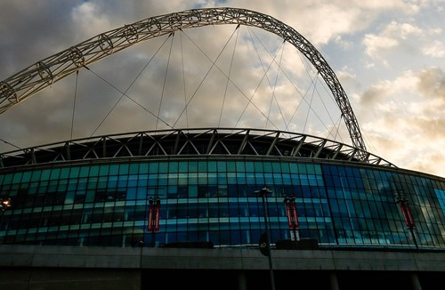 Wembley Stadium lights up for City